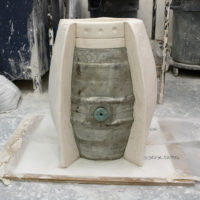 Wooden structure made to start the first plaster mould around the keg