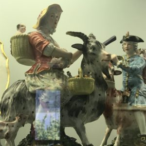 colourful porcelain figurines of a woman on a donkey with 2 babies and her husband the talilor