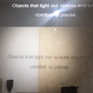 text in cabinet at derby museu, 'object that lith our space and bring comfort to places'