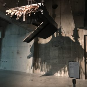 REbecca Horn Piano sculpture - upside down with wings with sign saying its resting ie not working
